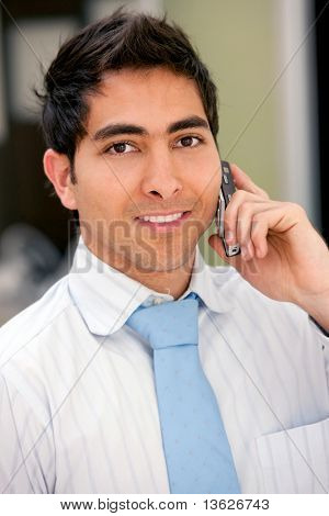 Business man talking on the phone and smiling