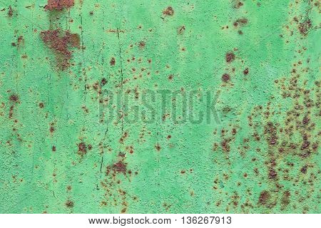 Corroded rusty  green metal background