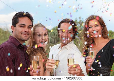 group champagne toast at party  celebration or wedding