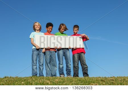 diverse kids holding blank sign