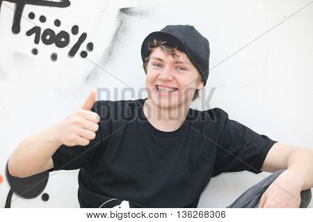 trendy happy teen boy thumbs up