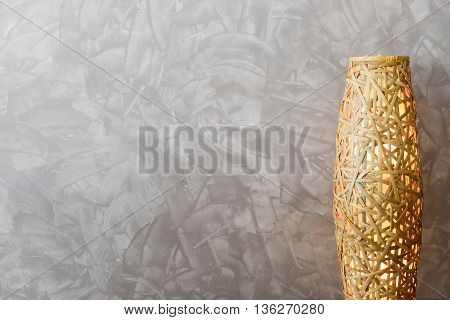 Wall space striped paint brush with weave bamboo LED lamp useful for background with text space copy space.