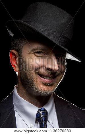Man wearing a fedora hat as a film noir detective or gangster