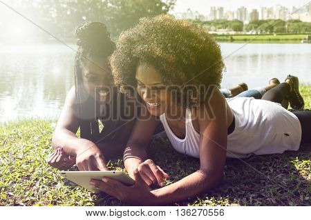 Afro women using tablet computer in the park