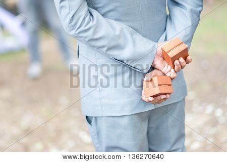 Wedding ring in wooden boxes with groomsmen.