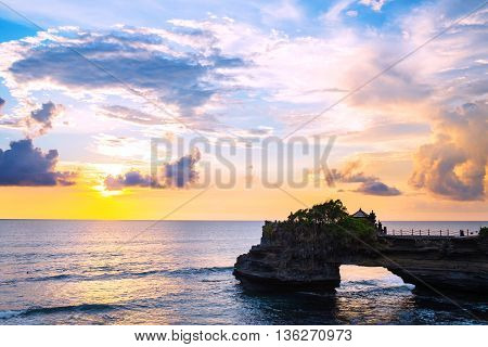 Landscape, Ocean in sunset with cliff and natural arch at Tanah lot, Bali