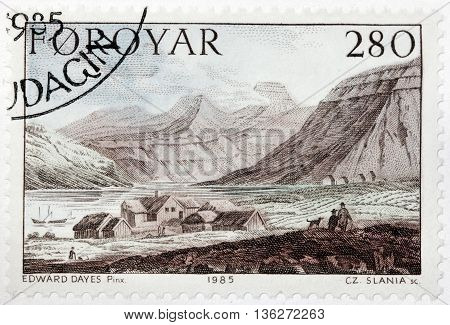 LUGA RUSSIA - JUNE 25 2016: A stamp printed by FAROE ISLANDS shows view of Torshavn town. Engraving after drawing by painting of famous English watercolour artist Edward Dayes circa 1985.