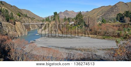Panoramic view of the Waiau River and Hanmer Bridge in the middle of Winter North Canterbury New Zealand.
