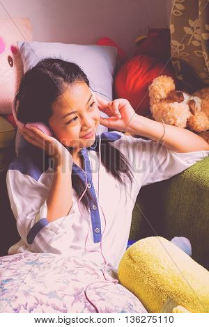 portrait girl listen music Young Asia girl with headphones teenage girl listening to music .