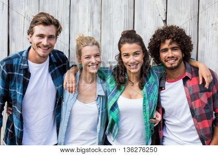 Group of friends standing with arms around