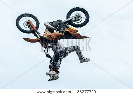 Tyumen, Russia - June 10, 2009: Red Bull X-Fighters Exhibition Tour. Freestyle Motocross. Daniel Bodin carries out a trick