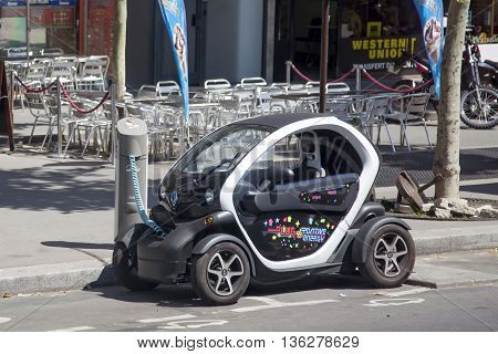 PARIS, FRANCE - JUNE 8, 2013:Electric Renault charges the battery on the street in Paris
