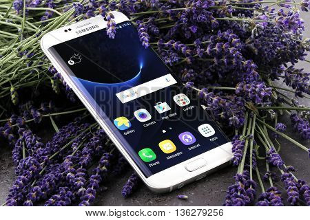 Koszalin, Poland  June 29, 2016: Photo of Samsung Galaxy S7 Edge white pearl. Samsung 7 Edge are new generation smartphone from Samsung. The Samsung S7 Edge is smart phone with multi touch screen