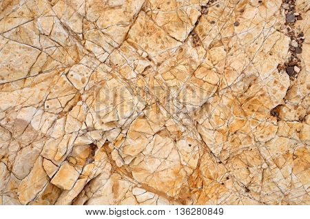 Texture background stone. Brown rock texture closeup of pictures in a geological park.Rock texture closeup of photo.