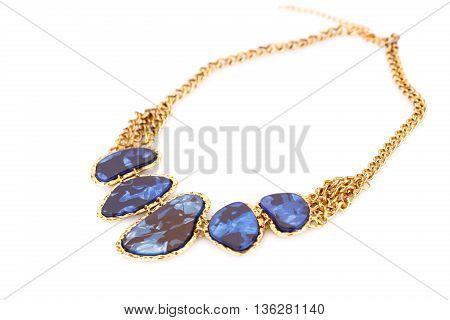 Stylish necklace with gemstones isolated on white background.
