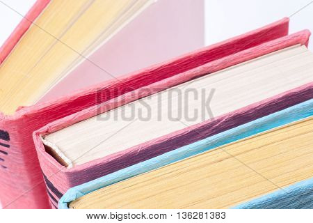 Top View Of Bright Colorful Hardback Books In A Circle. Open Book, Fanned Pages. Education Essential