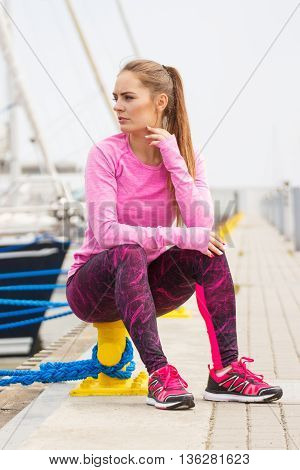 Pensive Girl In Sports Wear Resting After Exercise In Seaport, Healthy Active Lifestyle