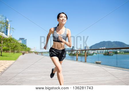 Young woman jogging in summer