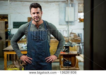 Carpenter smiling on his workshop