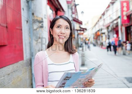 Woman looking at city map in Macao city