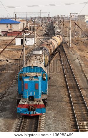 Tyumen, Russia - April 15, 2006: The shunting locomotive transports cars on Voynovka station