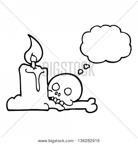 freehand drawn thought bubble cartoon spooky skull and candle