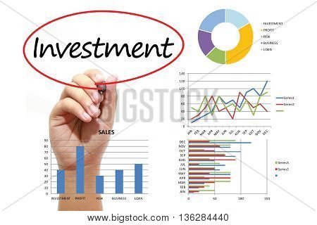 Businessman writing Investment in red circual on virtual screen. Business banking finance and investment concept.