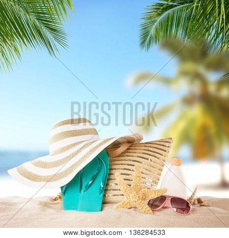 Summer concept of beach relaxation with accessories for sunbathing