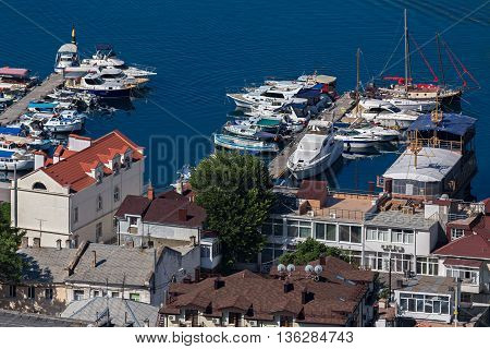 Sevastopol, Russia - June 09, 2016: Yachts and boats in the Balaclava Bay. Former submarine base.