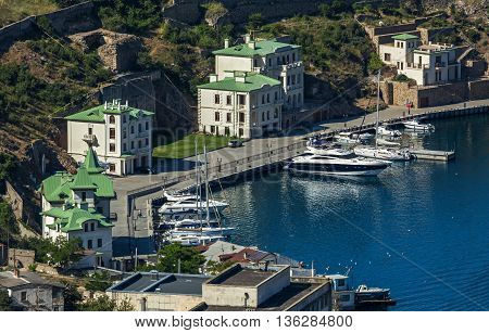 Sevastopol, Russia - June 09, 2016: New promenade with restored old houses famous people in the past. Balaklava bay.