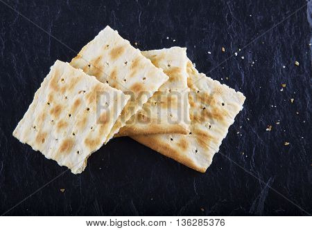 Crackers Over Black Stone Background