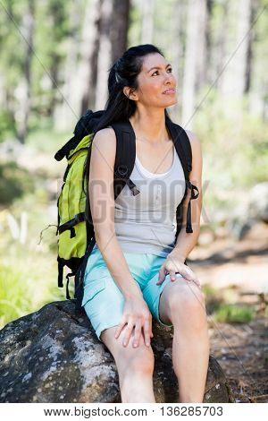 Woman sitting and looking up on the wood
