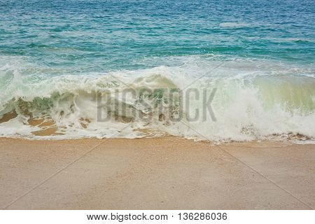 Wave of the ocean on the sand beach, Bali, Indonesia
