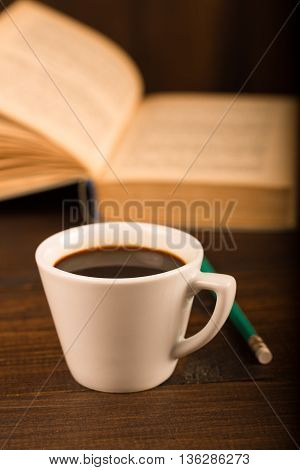 cup of coffee with book in coffee shop