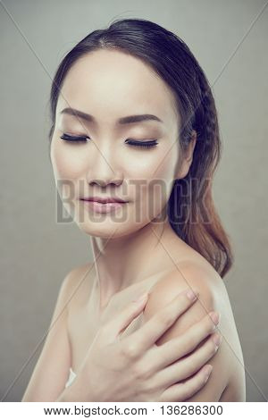 Portrait of smiling young woman with perfect skin