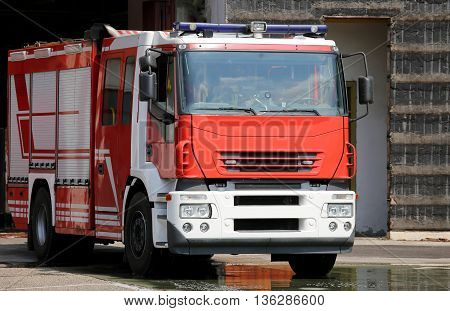 Red Fire Engine Truck During A Fire Drill