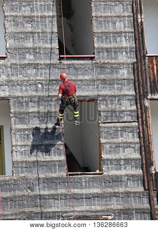 Climber Firefighter Rappelling The Wall