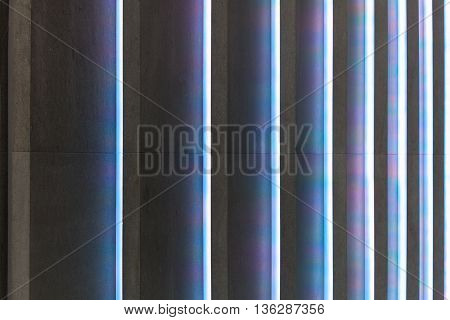 abstract concrete stripes with colorful light ridges