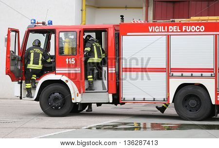Fire Engine Carrying Two Firefighters
