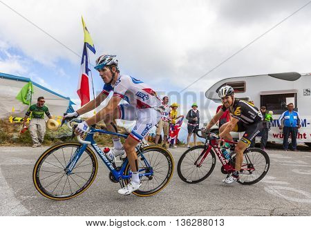 Col de la Croix de Fer, France - 25 July 2015:The French cyclist Arnaud Demare of FDJ Team and the american cyclist Tyler Farrar of MTN-Qhubeka Team in the peloton riding to the Col de la Croix de Fer in Alps during the stage 20 of Le Tour de France 2015.