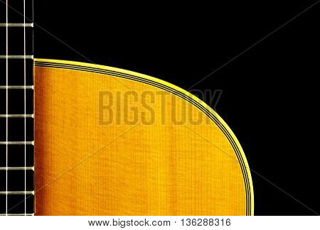Acoustic guitar neck and body isolated against a black background