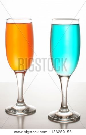 Two Glasses Of Champagne With Colored Liquids