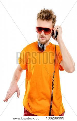 Happy young stylish man in headphones enjoying the music and expressing positive. Isolated over white.