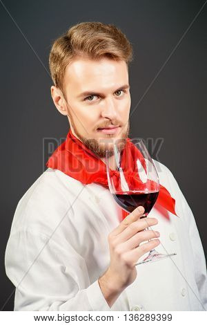 Male sommelier tasting red wine. Wine making. Occupations.