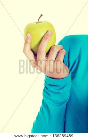 Casual woman holding an apple.