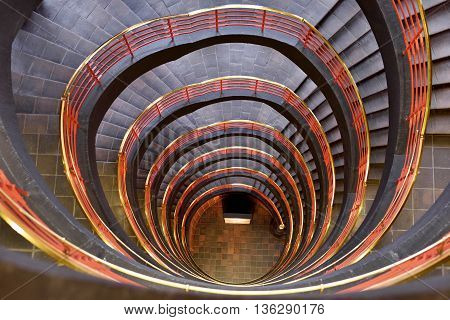 Spiral staircase with red boundary. View from high up.