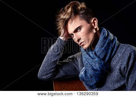 Portrait of a handsome young man with stylish haircut. Men's beauty, fashion.