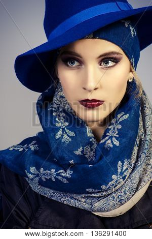 Studio fashion shot. Portrait of a fashionable young woman. Accessories, make-up, cosmetics.
