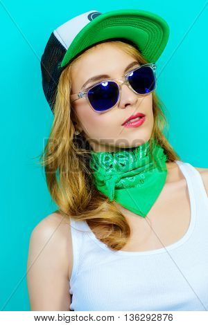 Modern girl in casual t-shirt and baseball cap. Beauty, youth  style. Studio shot.
