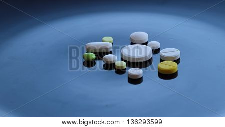 Medical tablets design. Different colored drug pills isolated